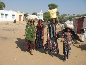 women and children carrying their daily needs on their head-wevolunteerinindia