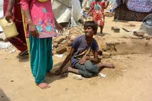 Preeti can stand with the support of volunteers in India